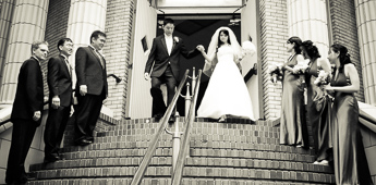 Bride and groom exiting church after wedding