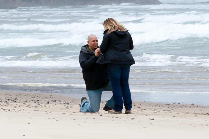 Engagement portrait of couple at the beach Lincoln City Oregon