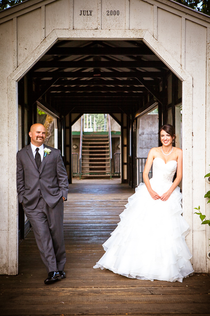 bridal portrait of couple by covered bridge in Silverton Oregon