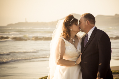 Bridal portrait of newlywed couple on the beach Newport Oregon