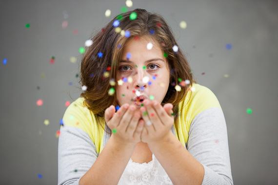 Senior photo in studio with glitter