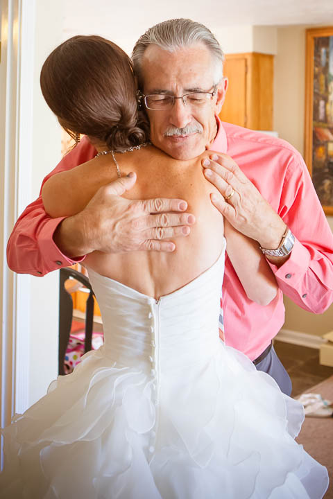 Father hugs bride - Photos By Orion