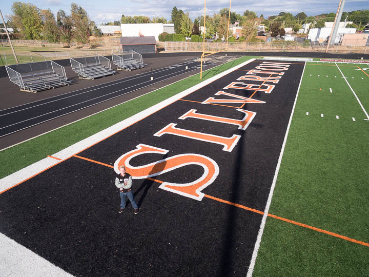 Drone photo of senior on football field - Photos By Orion