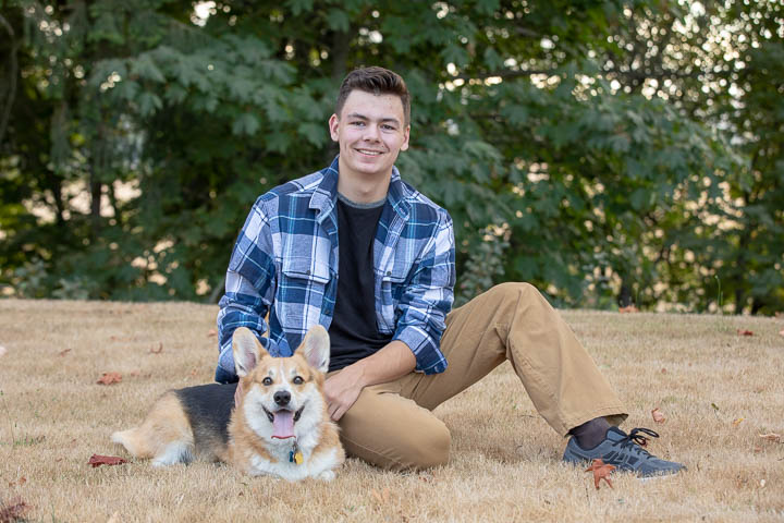 Senior posing with his dog